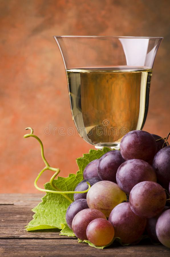 Close-up with bunch of red grapes and glass of wine stock photography