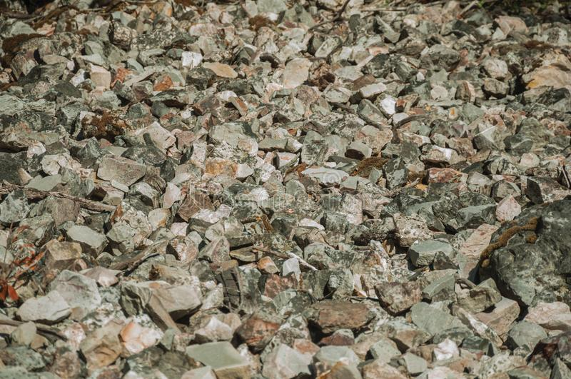 Bunch of rough stones lying on the slope. Close-up of a bunch of rough stones lying on the slope at the Monfrague National Park. A remarkable place with a stock photography