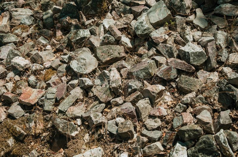 Bunch of rough stones lying on the slope. Close-up of a bunch of rough stones lying on the slope at the Monfrague National Park. A remarkable place with a stock photo