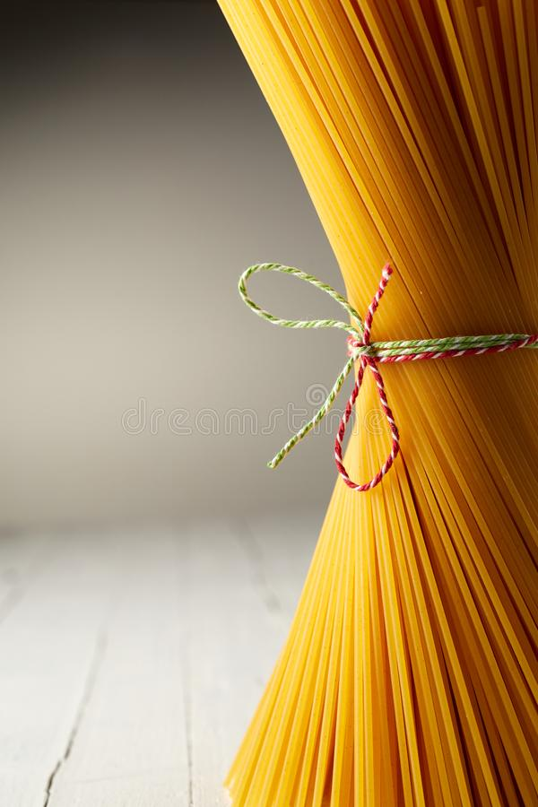 Close up of bundled and tied uncooked spaghetti royalty free stock images