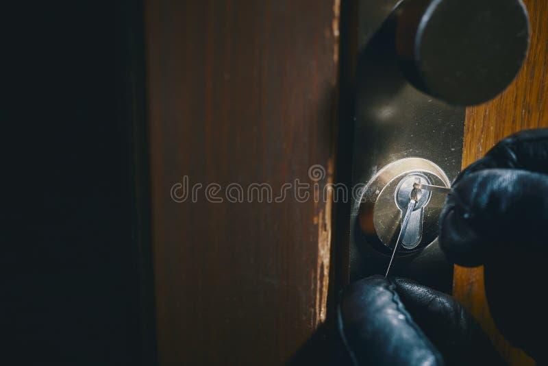 Close up burglar picking a lock royalty free stock image