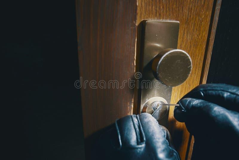 Close up burglar picking a lock stock image