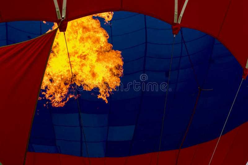 Close-up burning burner, bright flame against Hot air balloon. Preparing to launch a flying air balloon. Festival of stock photos