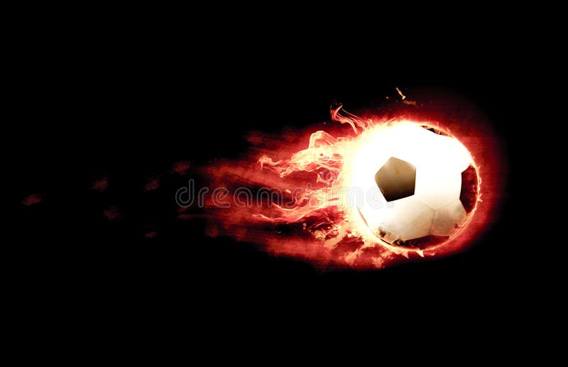 Burning soccer ball with a tail of flames royalty free stock image