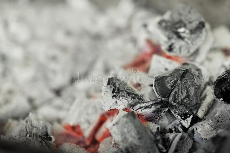 Close up of burnt black coal with red heat in brazier royalty free stock image