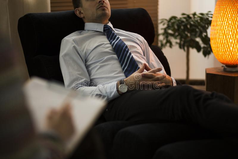 Close-up of burnt-out corporate employee. During therapy with advisor royalty free stock images