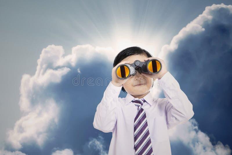 Close-up business boy holding binoculars outdoor stock image