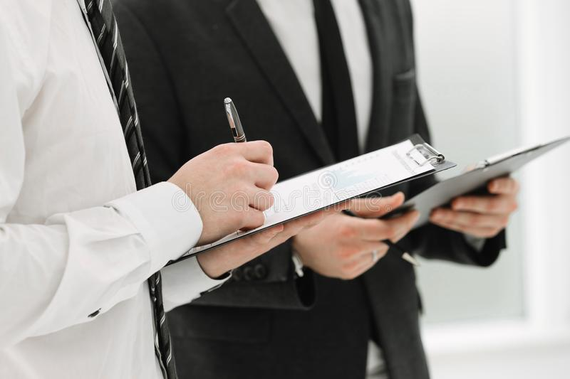 Close up. business colleagues discussing documents with financial data royalty free stock photos