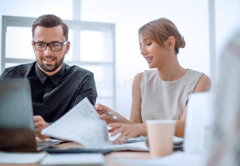 Close up. business colleagues sitting at the Desk. royalty free stock photo