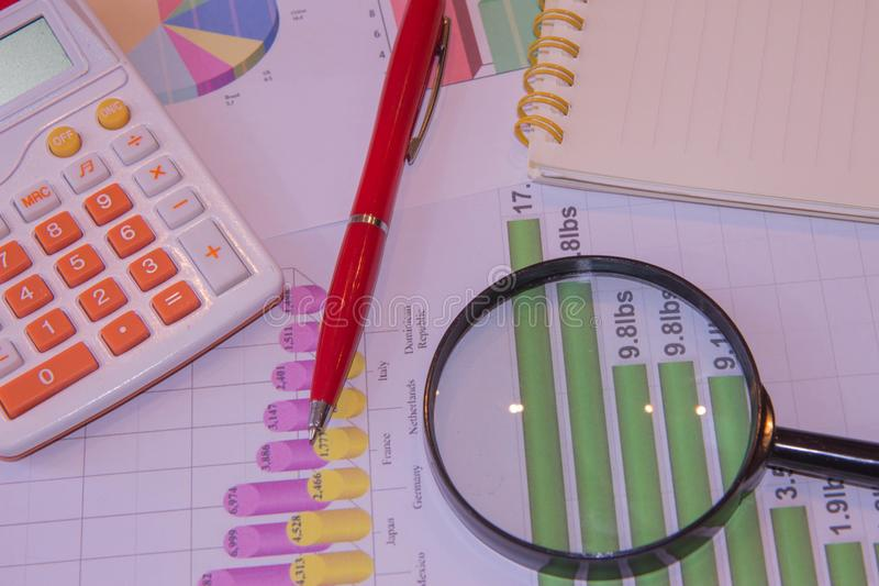 Close up business concept, Calculator, magnifier, pen on financial report on table office stock photos