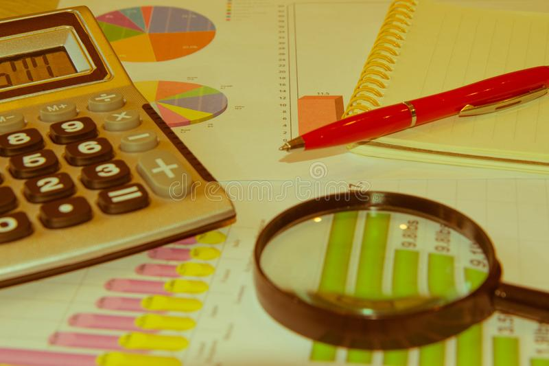 Close up business concept, Calculator, magnifier, pen on financial report on table office royalty free stock images