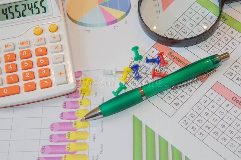 Close up business concept, calculator, magnifier, pen on financial report on table office royalty free stock photos