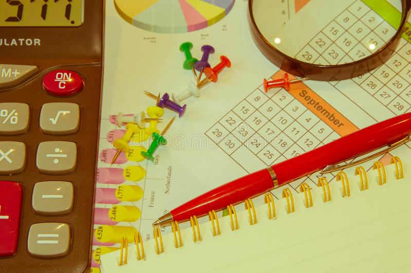 Close up business concept, Calculator, magnifier, pen on financial report on table office stock image