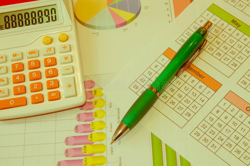 Close up business concept, Calculator, magnifier, pen on financial report on table office stock photography