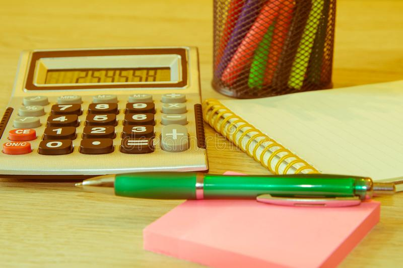 Close up business concept, Calculator, notebook, pen on financial report on table office stock photos