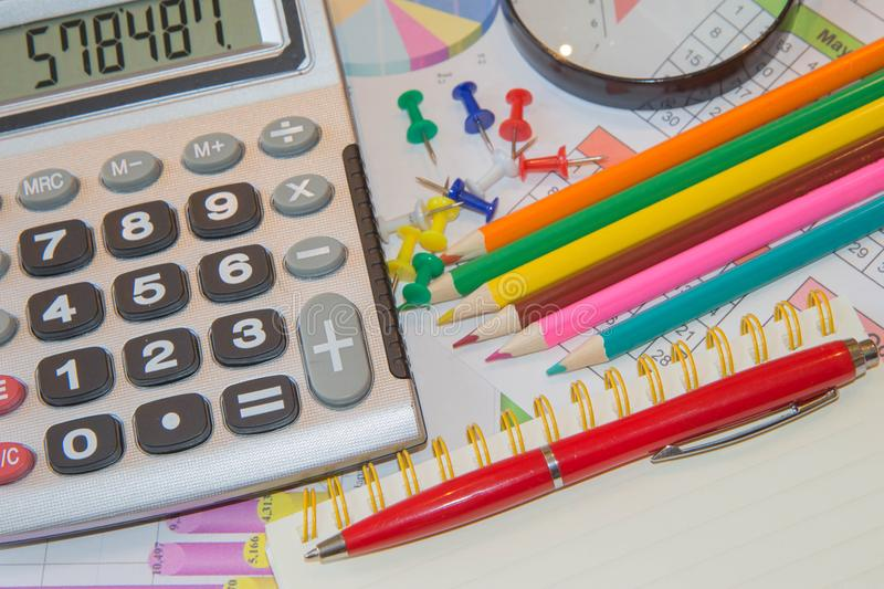 Close up business concept, Calculator, pencil, pen on financial report on table office royalty free stock images