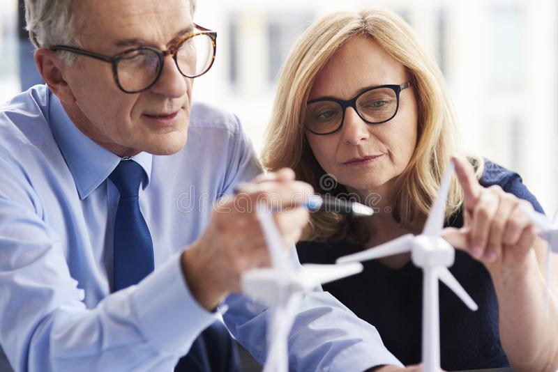 Close up of business couple working together. In the modern office royalty free stock photo