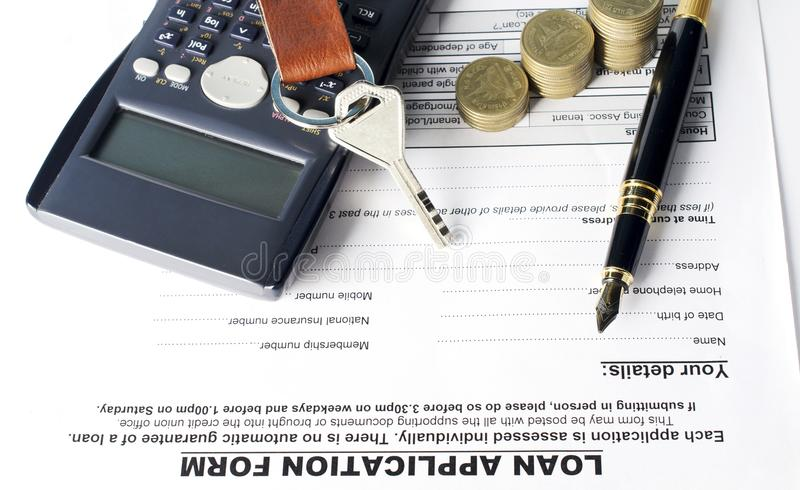 Close up of business fountain pen with coins stack and home key. And calculator for finance concept backgrounds above royalty free stock photo