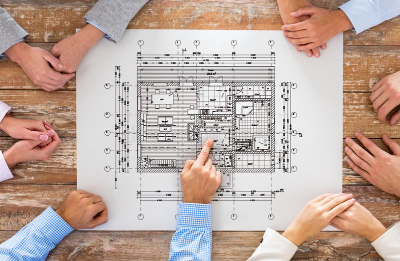 Close up of business group with blueprint stock illustration business people architecture and team work concept close up of architects team hands pointing finger to blueprint at office table malvernweather Gallery