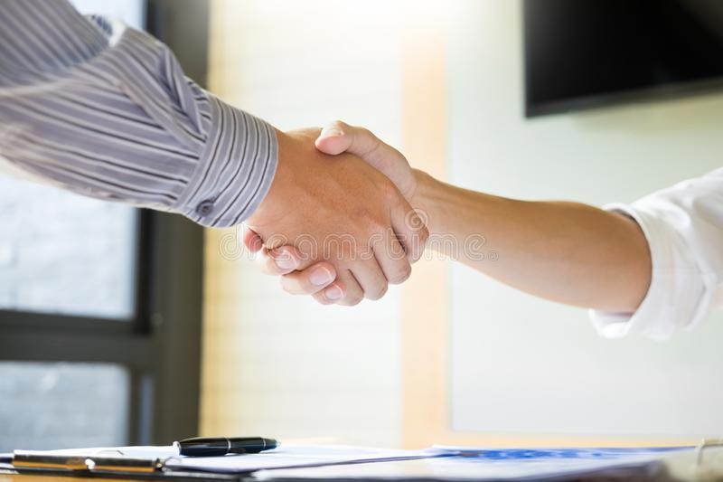 Close up of a business handshake, finishing up a meeting acquisition Greeting Deal concept. Close up of a business handshake, finishing up a meeting acquisition stock photography