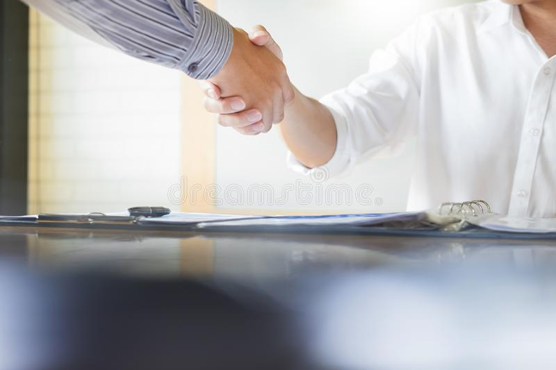 Close up of a business handshake, finishing up a meeting acquisition Greeting Deal concept. stock image