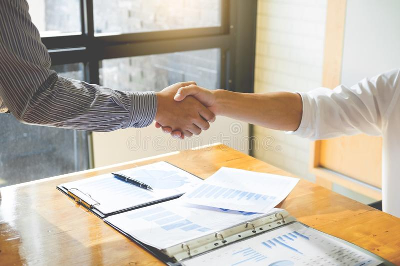 Close up of a business handshake, finishing up a meeting acquisition Greeting Deal concept. ใ royalty free stock image