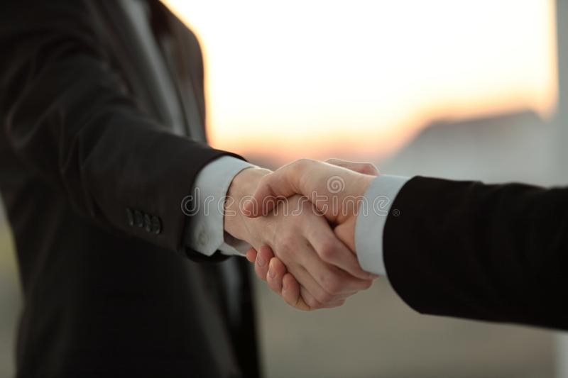 Close up.business handshake over blurry background. stock photography