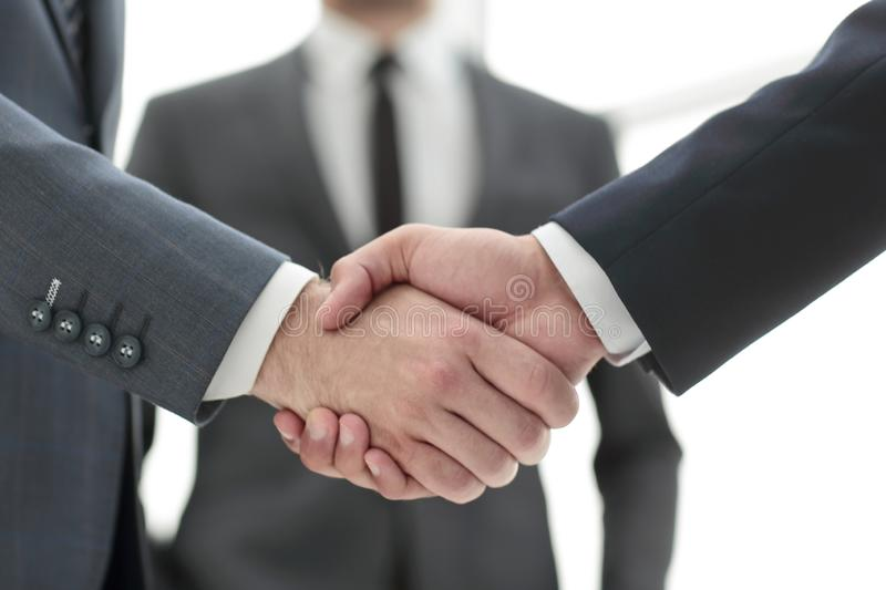 Close up.business handshake over blurry background. royalty free stock photo