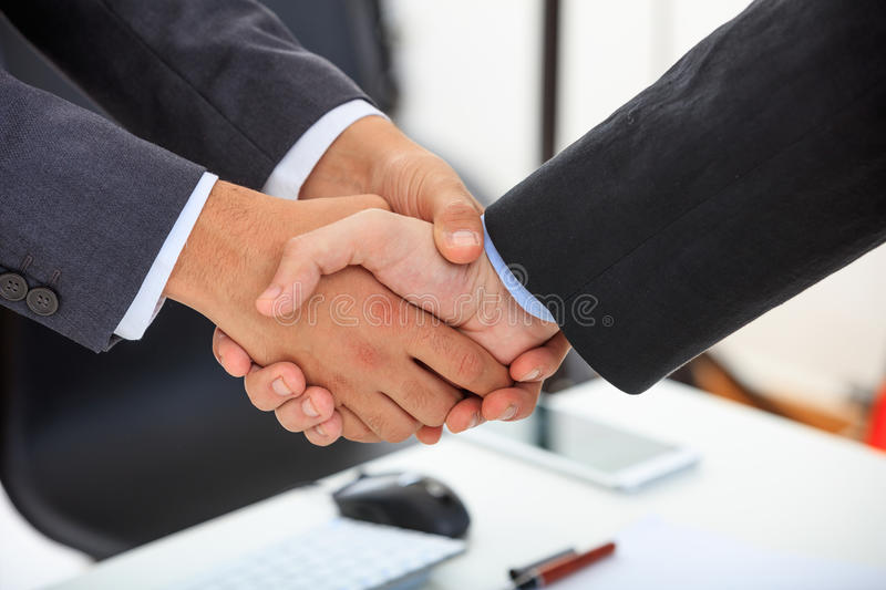 Close up of business handshake. Business people greeting each other royalty free stock images