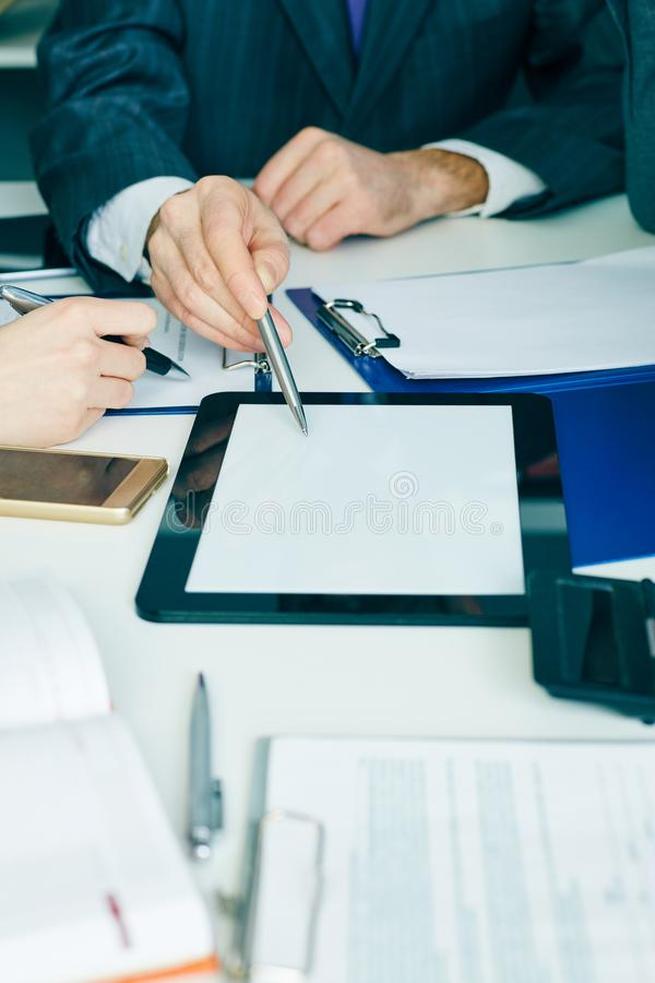 Close-up the business man hand pointing at the tblank tablet screen. Teamwork successful meeting. stock images