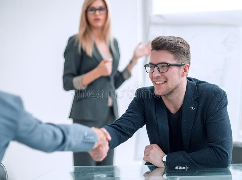 Close up. business man shaking hands with his business partner. stock images