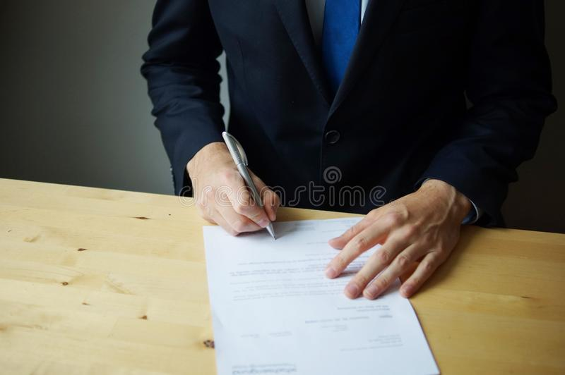 Close up business man signing contract. stock photo