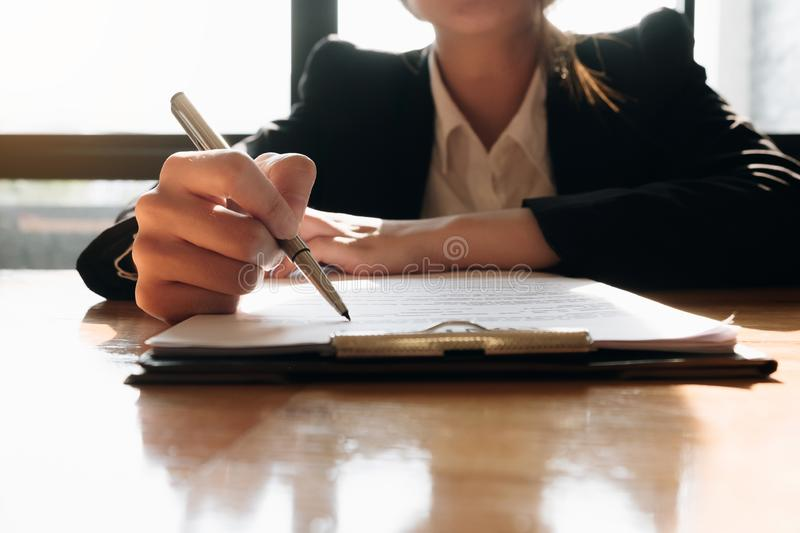 Close up business man signing contract making a deal with business partner - Business deal concept stock photo