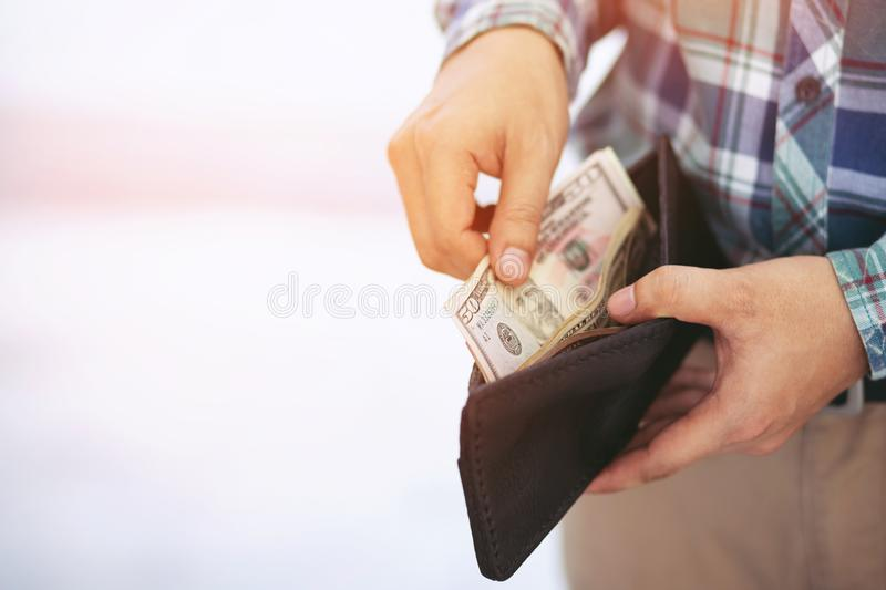 Close up business man standing  hand hold Count the money spread of cash. concept finance Saving money. stock photography