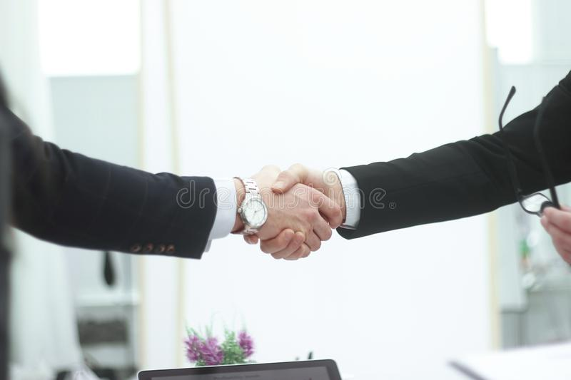 Close up.business men shaking hands on blurred background office stock photos