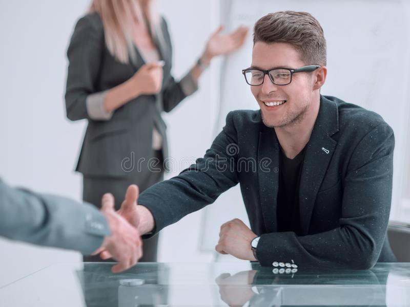 Close up. business man shaking hands with his business partner. Close up. business men shaking hands with his business partner. concept of cooperation royalty free stock photo