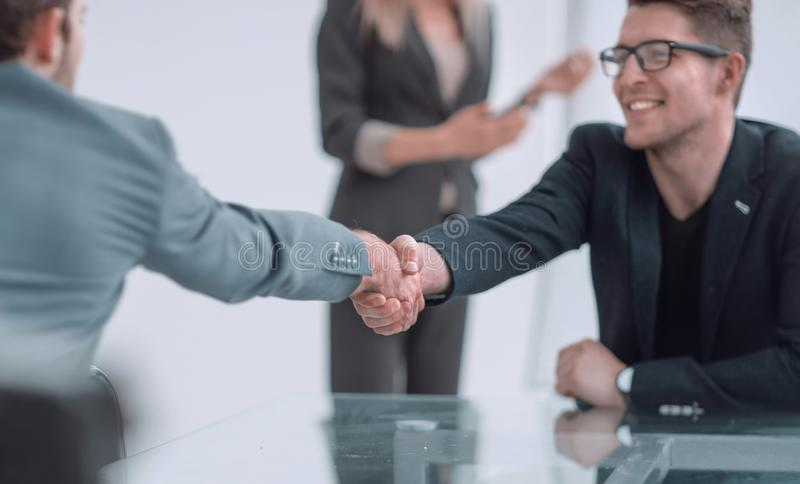 Close up. business man shaking hands with his business partner. Close up. business men shaking hands with his business partner. concept of cooperation stock images