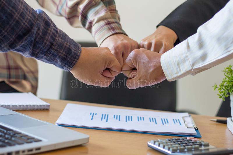 Close-up of business partners making pile of hands at meeting,Team work royalty free stock photography