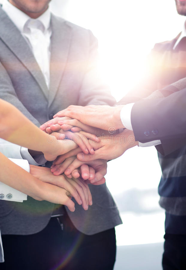 Close-up of business partners making pile of hands at meeting royalty free stock photography