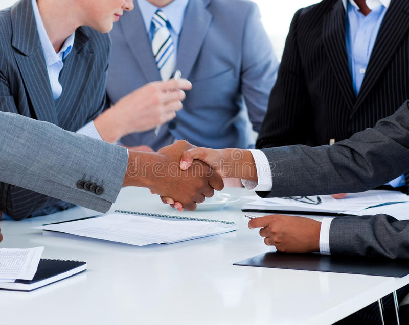 Close-up of business people greeting each other. In a meeting stock images