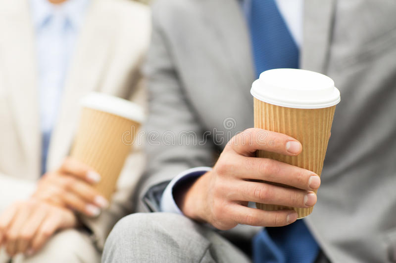 Close up of business people hands with coffee cups royalty free stock image