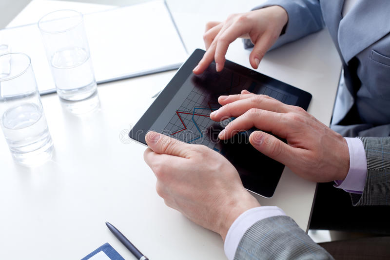 Close up of business people' hands with a Liquid-Crystal Displa stock photography