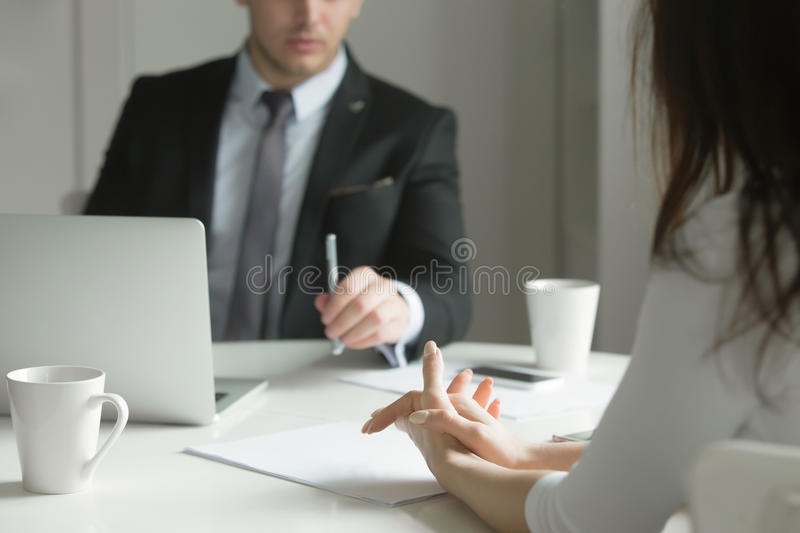 Close up of business people hands at office desk royalty free stock image
