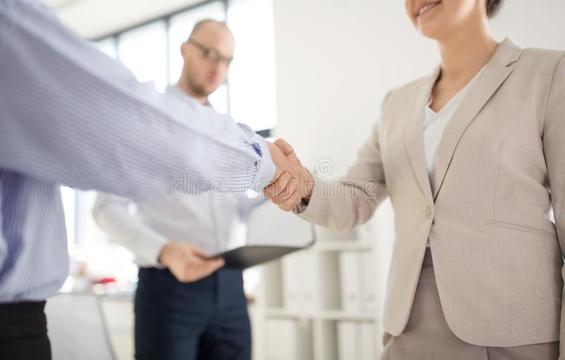 Close up of business people making handshake royalty free stock images