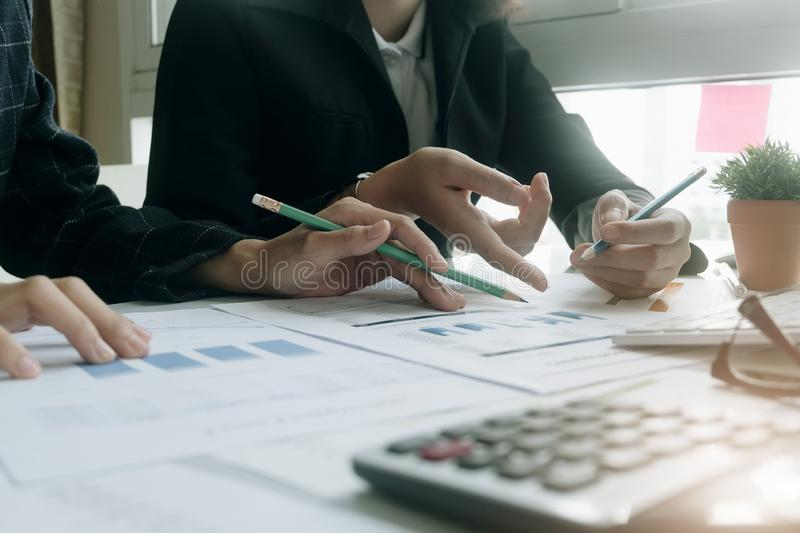 Close up Business people meeting to discuss the situation on the market. Business Financial Concept stock photo
