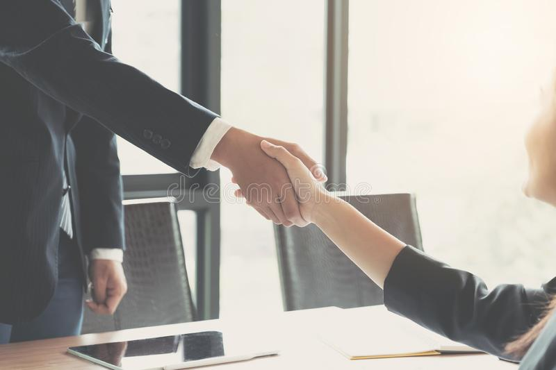 Close up of Business people shaking hands, finishing up meeting, business etiquette, congratulation, merger and acquisition. Concept royalty free stock image