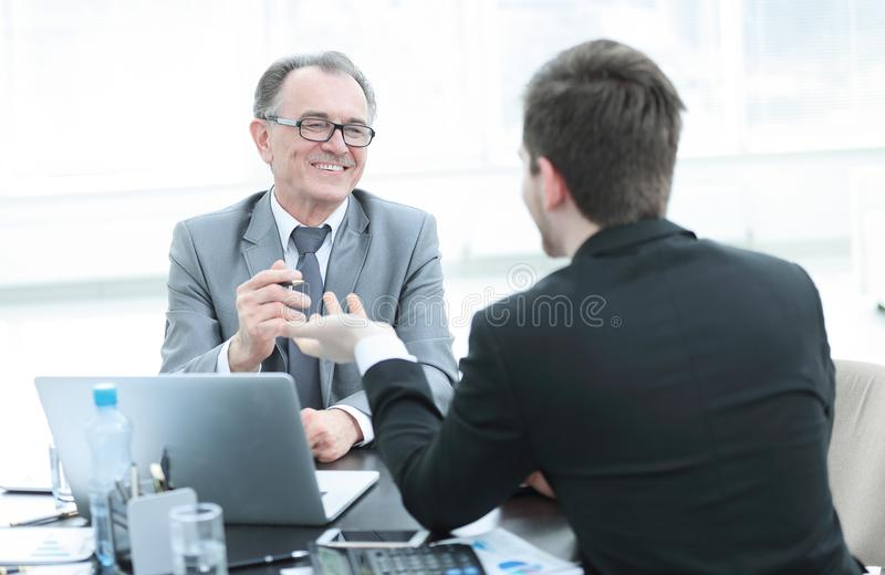Close up.business people talking at a Desk. Meetings and partnership stock photography