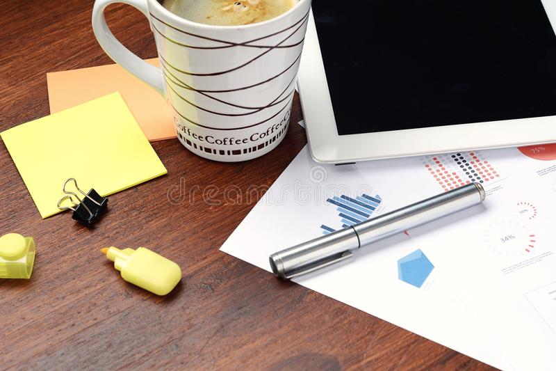 Close up of business stuff with technology devices and cup of co stock photography