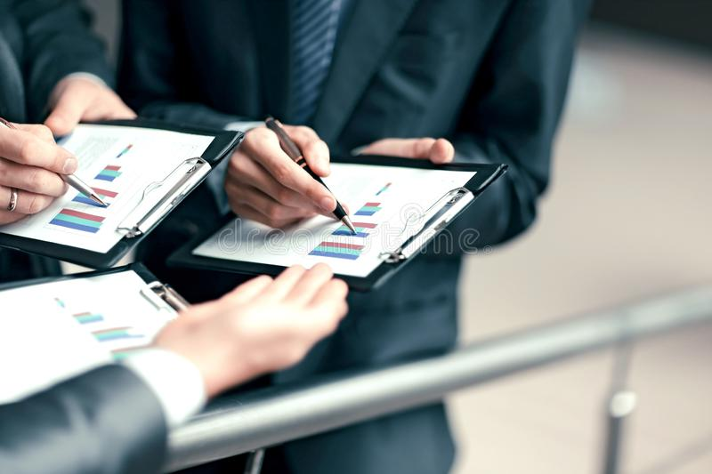 Close up.business team analyzes the financial profit of the com. Pany royalty free stock image