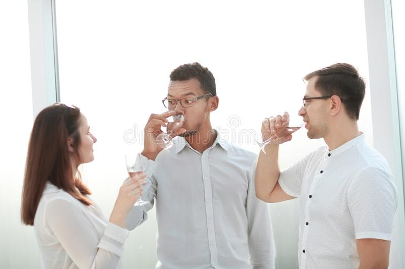 Close up.business team clinking glasses of wine. The concept of a successful startup stock photography